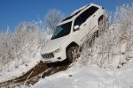 Jeep Grand Cherokee 5.7 V8 HEMI Test - Vorne seitlich Front Seite Ansicht Berg