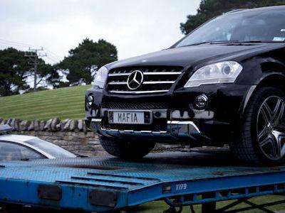 Kim Schmitz Megaupload Kimble Dotcom Villa Coatesville Neuseeland Mercedes-Benz G 55 AMG Police Beschlagnahmung beschlagnahmen konfiszieren Polizei Autotransport Fuhrpark Autosammlung